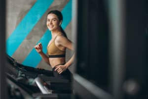 healthy woman running track gym 1303 22549